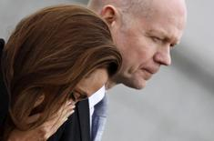 U.S. actress Angelina Jolie reacts with Britain's Foreign Secretary William Hague after paying respects to female victims and laying a wreath in front of the Srebrenica Genocide Memorial in Potocari March 28, 2014. REUTERS/Dado Ruvic