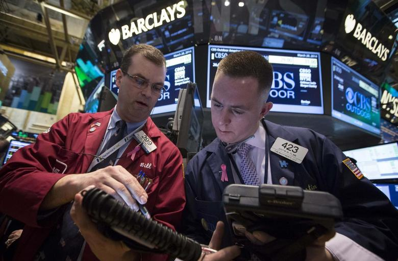 Traders William Lawrence and Justin Flinn (R) work on the floor of the New York Stock Exchange March 28, 2014. REUTERS/Brendan McDermid