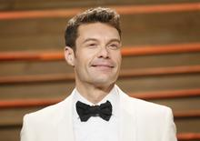 Ryan Seacrest arrives at the 2014 Vanity Fair Oscars Party in West Hollywood, California March 2, 2014. REUTERS/Danny Moloshok