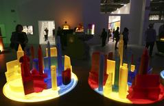People view art pieces based on the bottle city of Kandor during an exhibition of work by the late artist Mike Kelley during a media preview at The Geffen Contemporary at The Museum of Contemporary Art (MOCA) in Los Angeles, California March 28, 2014. REUTERS/Jonathan Alcorn