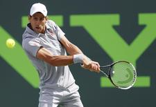 Mar 30, 2014; Miami, FL, USA; Novak Djokovic hits a backhand against Rafael Nadal (not pictured) during the men's singles final of the Sony Open at Crandon Tennis Center. Mandatory Credit: Geoff Burke-USA TODAY Sports - RTR3J84K