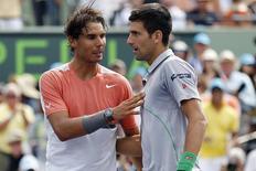 Mar 30, 2014; Miami, FL, USA; Novak Djokovic (right) shakes hands with Rafael Nadal (left) after winning the men's singles final of the Sony Open at Crandon Tennis Center. Djokovic won 6-3, 6-3. Mandatory Credit: Geoff Burke-USA TODAY Sports - RTR3J8A1