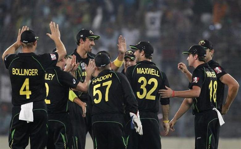 Australia's fielders celebrate the dismissal of India's Rohit Sharma during their ICC Twenty20 World Cup match at the Sher-e-Bangla National Cricket Stadium in Dhaka March 30, 2014. REUTERS/Andrew Biraj