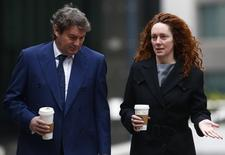 Former News International executive Rebekah Brooks and her husband Charlie arrive at the Old Bailey in central London March 17, 2014. REUTERS/Andrew Winning