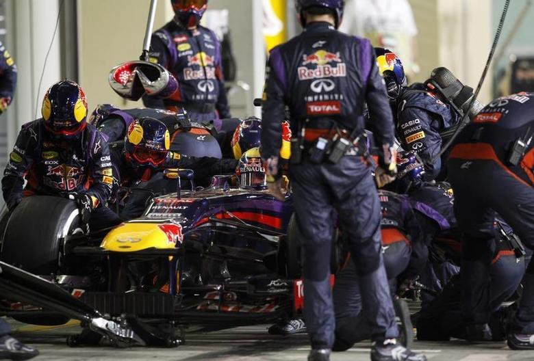 Red Bull Formula One driver Sebastian Vettel of Germany waits to leave the pit during the Abu Dhabi F1 Grand Prix at the Yas Marina circuit on Yas Island, November 3, 2013. REUTERS/Caren Firouz