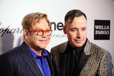 Musician Elton John (L) and his husband David Furnish pose at the 2014 Elton John AIDS Foundation Oscar Party in West Hollywood, California March 2, 2014. REUTERS/Gus Ruelas