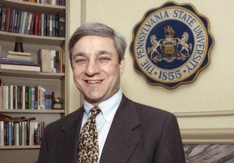 Penn State University President Graham Spanier poses in his office in the Old Main building in State College, Pennsylvania, in this February 26, 1997 file photo. REUTERS/Craig Houtz