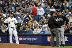 Mar 31, 2014; Milwaukee, WI, USA; Atlanta Braves manager Fredi González challenged a call by first base umpire Greg Gibson that Milwaukee Brewers left fielder Ryan Braun (8) was safe in the sixth inning of an opening day baseball game at Miller Park. The call was reversed and Braun was called out after umpires reviewed instant replay. Benny Sieu-USA TODAY Sports - RTR3JEDQ