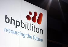 A promotional sign adorns a stage at a BHP Billiton function in central Sydney August 20, 2013. REUTERS/David Gray