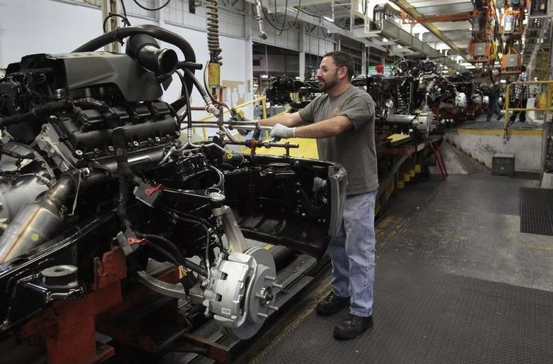 Chrysler assembly staff works on the chassis of a 2014 Dodge Ram pickup truck at the Warren Assembly Plant in Warren, Michigan December 11, 2013. REUTERS/Rebecca Cook