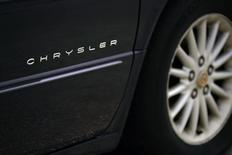 A Chrysler logo is seen on a car at a Chrysler car dealership in Toronto, April 30, 2009. REUTERS/Peter Jones