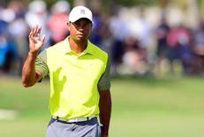 Mar 7, 2014; Miami, FL, USA; Tiger Woods acknowledges after a putt on the 18th green during the first round of the WGC - Cadillac Championship golf tournament at TPC Blue Monster at Trump National Doral. Andrew Weber-USA TODAY Sports
