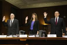 Caterpillar Inc former Senior International Tax Manager Rodney Perkins (L-R), Vice President for Finance Services Julie Lagacy and Chief Tax Officer Robin Beran are sworn in to testify at a U.S. Senate Permanent Subcommittee on Investigations hearing on Caterpillar's offshore tax strategy on Capitol Hill in Washington April 1, 2014. REUTERS/Jonathan Ernst