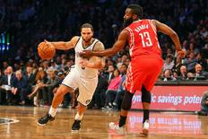 Apr 1, 2014; Brooklyn, NY, USA; Brooklyn Nets guard Deron Williams (8) dribbles the ball past Houston Rockets guard James Harden (13) during the third quarter at Barclays Center. The Nets defeated the Rockets 105-96. Mandatory Credit: Ed Mulholland-USA TODAY Sports