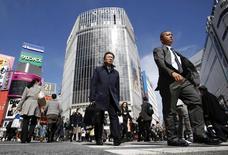 Pedestrians walk at a scramble crossing at Shibuya shopping district in Tokyo February 28, 2014. REUTERS/Yuya Shino