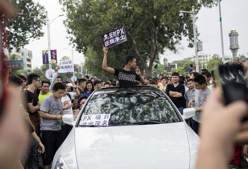 China city hit by protest over chemical plant vows to talk to citizens