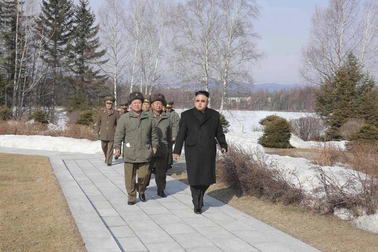 North Korean leader Kim Jong Un (R) meets the commanding officers of the combined units of the Korean People's Army (KPA) in this undated photo released by North Korea's Korean Central News Agency (KCNA) in Pyongyang April 2, 2014. REUTERS/KCNA