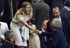 Barbara Berlusconi, daughter of former Italian Prime Minister Silvio Berlusconi, arrives in the tribune before the Champions League Group H soccer match between AC Milan and Celtic at San Siro stadium in Milan September 18, 2013. REUTERS/Max Rossi