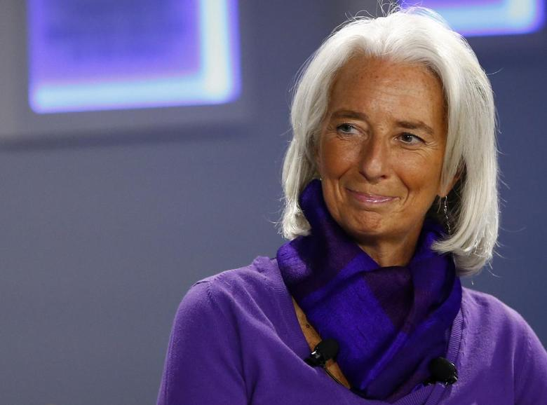 Christine Lagarde, Managing Director of the International Monetary Fund (IMF) smiles during a session at the annual meeting of the World Economic Forum (WEF) in Davos January 23, 2014. REUTERS/Ruben Sprich