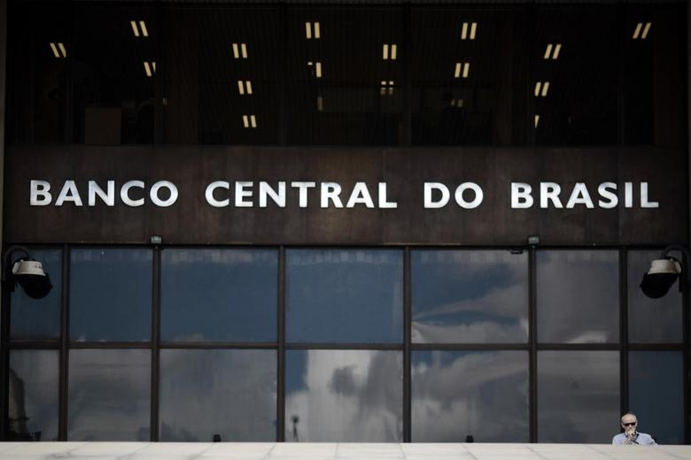 A man walks out of the headquarters of the central bank in Brasilia January 15, 2014. REUTERS/Ueslei Marcelino