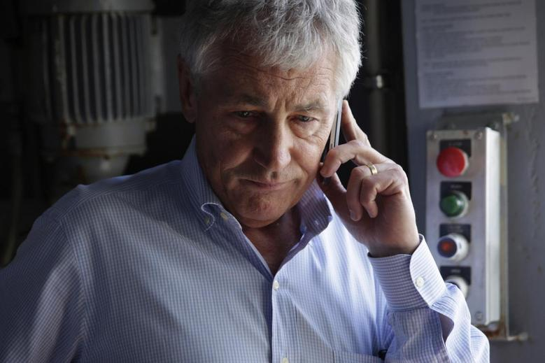 U.S. Secretary of Defense Chuck Hagel receives an update on the phone after a report of a shooting at Ft. Hood, Texas, while he is touring the USS Anchorage (LPD-23), an amphibious transport dock ship, with his counterparts from Southeast Asia at the Joint Base Pearl Harbor-Hickam in Honolulu, Hawaii April 2, 2014. REUTERS/Alex Wong