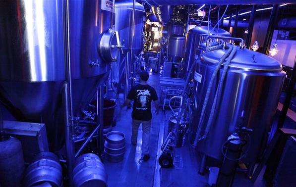 Assistant brewer Kenny Stulyr works at Tequesta Brewing Co. in Tequesta, Florida April 2, 2014. REUTERS-Javier Galeano