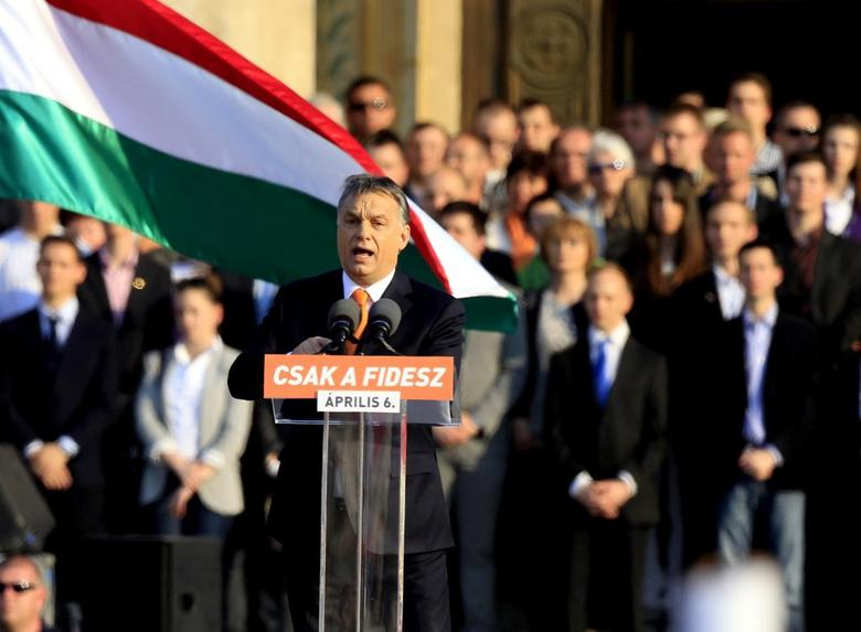 Hungarian Prime Minister Viktor Orban delivers a speech during an election rally of ruling Fidesz party in Budapest, March 29, 2014. REUTERS/Bernadett Szabo