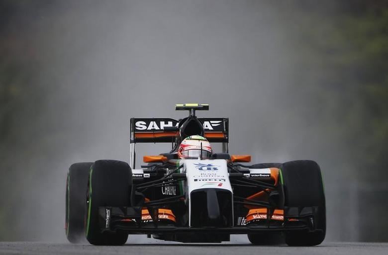Force India Formula One driver Sergio Perez of Mexico drives during the qualifying session for the Malaysian F1 Grand Prix at Sepang International Circuit outside Kuala Lumpur, March 29, 2014. REUTERS/Samsul Said