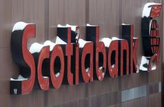 Snow covers the Scotiabank logo at the Bank of Nova Scotia headquarters in Toronto December 16, 2013. REUTERS/Chris Helgren