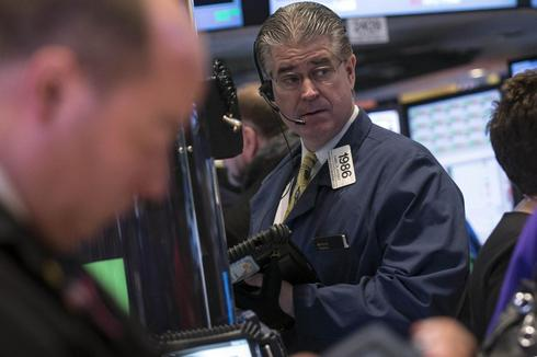 Wall Street dips as investors wary before jobs data