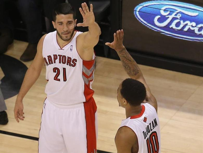 Apr 2, 2014; Toronto, Ontario, CAN; Toronto Raptors guard DeMar DeRozan (10) is congratulated by guard Greivis Vasquez (21) after scoring a basket against the Houston Rockets at Air Canada Centre. Tom Szczerbowski-USA TODAY Sports