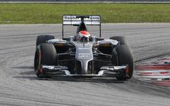 Sauber Formula One driver Adrian Sutil of Germany takes a corner during the Malaysian F1 Grand Prix at Sepang International Circuit outside Kuala Lumpur, March 30, 2014. REUTERS/Samsul Said