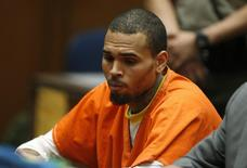 R&B singer Chris Brown, who pleaded guilty to assaulting his girlfriend Rihanna, appears in court for allegedly violating his probation, in Los Angeles, California, March 17, 2014. REUTERS/Lucy Nicholson