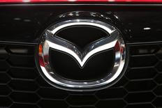 The company logo is seen on the bonnet of a Mazda car during the media day ahead of the 84th Geneva Motor Show at the Palexpo Arena in Geneva March 5, 2014. REUTERS/Arnd Wiegmann