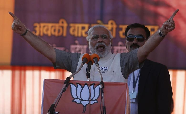 Hindu nationalist Narendra Modi, prime ministerial candidate for the main opposition Bharatiya Janata Party (BJP), gestures as he address a rally in Gurgaon on the outskirts of New Delhi April 3, 2014. REUTERS/Adnan Abidi