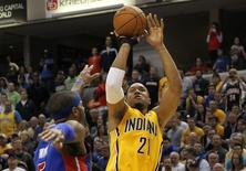 Apr 2, 2014; Indianapolis, IN, USA; Indiana Pacers forward David West (21) shoots the ball over Detroit Pistons forward Josh Smith (6) during the fourth quarter at Bankers Life Fieldhouse. Pat Lovell-USA TODAY Sports