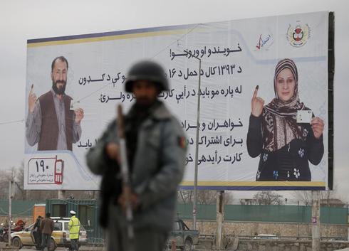 Amid spate of violence, Afghans vote to choose new leader