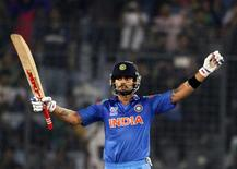 India's Virat Kohli celebrates after India won the semi final match against South Africa in the ICC Twenty20 World Cup at the Sher-E-Bangla National Cricket Stadium in Dhaka April 4, 2014. REUTERS/Andrew Biraj