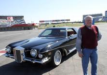 Automobile restorer Walt Hollifield poses with Elvis Presley's 1973 Stutz Blackhawk III during a media event at Charlotte Motor Speedway (CMS) in Charlotte, North Carolina April 1, 2014, in this handout courtesy of CMS. REUTERS/CMS/HHP/Handout via Reuters