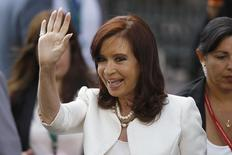 Argentina's President Cristina Fernandez de Kirchner waves to the media before a meeting with Chile's President-elect Michelle Bachelet (not pictured) in Santiago, March 10, 2014. REUTERS/Cristobal Saavedra