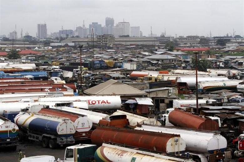 Trucks are seen parked around an automobile workshop overlooking the Lagos business district at the Orile-Iganmu in Lagos August 29, 2013. REUTERS/Akintunde Akinleye/Files