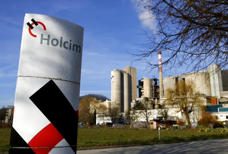 A Holcim logo is pictured in front of the cement works in Eclepens near Lausanne February 25, 2014. REUTERS/Denis Balibouse
