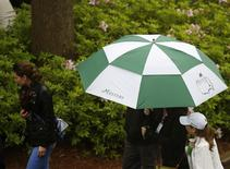 Patrons leave after play was suspended and the course closed due to inclement weather during a practice round ahead of the Masters golf tournament at the Augusta National Golf Club in Augusta, Georgia April 7, 2014. REUTERS/Jim Young