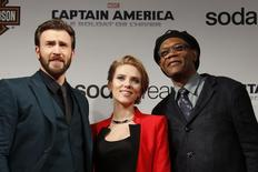 """Cast members Chris Evans, Scarlett Johansson and Samuel L Jackson pose at the French premiere of the film """"Captain America: The Winter Soldier"""" in Paris in this March 17, 2014, file photo. REUTERS/Benoit Tessier/Files"""