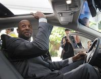 Miami Heat executive and former National Basketball Association player Alonzo Mourning checks the headroom in the new Lincoln MKZ premium mid-size sedan as it is unveiled by the Ford Motor Company at a press event at the Biltmore Hotel in Coral Gables, Florida December 3, 2012. REUTERS/Andrew Innerarity