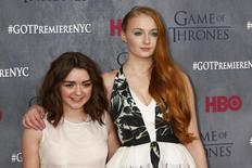 """Cast members Maisie Williams and Sophie Turner arrive for the season four premiere of the HBO series """"Game of Thrones"""" in New York March 18, 2014. REUTERS/Lucas Jackson"""