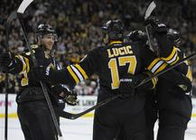 Apr 5, 2014; Boston, MA, USA; Boston Bruins left wing Milan Lucic (17) celebrates with teammates after scoring a goal during the second period against the Philadelphia Flyers at TD Banknorth Garden. Bob DeChiara-USA TODAY Sports