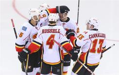 Apr 7, 2014; Newark, NJ, USA; The Calgary Flames celebrate a goal by defenseman Mark Giordano (5) during the third period against the New Jersey Devils at Prudential Center. Ed Mulholland-USA TODAY Sports