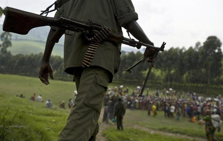 A Democratic Forces for the Liberation of Rwanda (FDLR) soldier walks toward a distribution center near Lushubere Camp in Masisi, km ( miles) northwest of Goma, December 19, 2008. REUTERS/T.J. Kirkpatrick