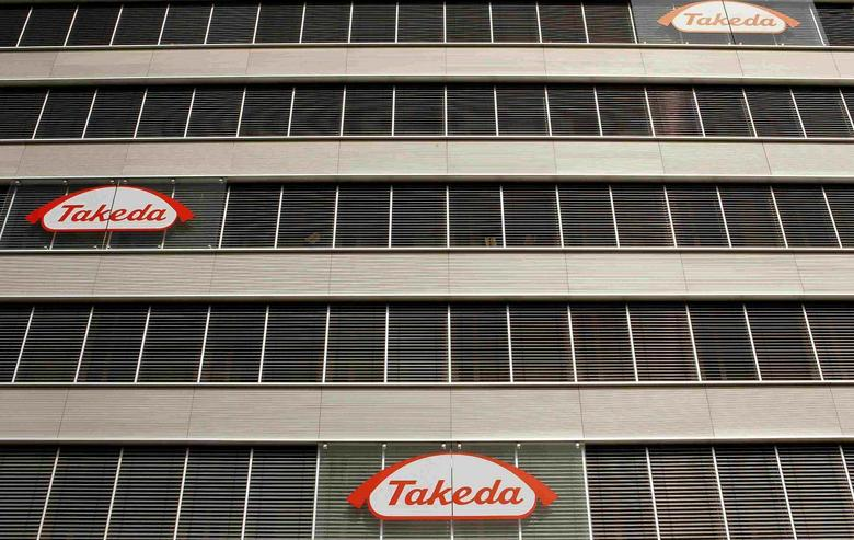 Logos of Japanese Takeda Pharmaceutical Co are seen at an office building in Glattbrugg near Zurich, in this March 7, 2012 file photo. REUTERS/Arnd Wiegmann/Files